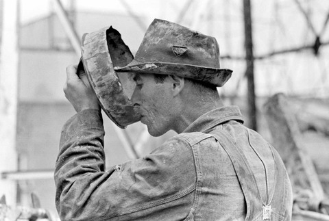 Oil field worker drinking water